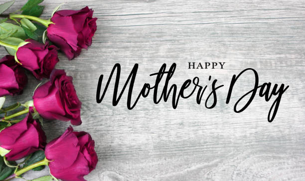 Happy Mother's Day Typography with Bright Pink Roses Over Wood Background